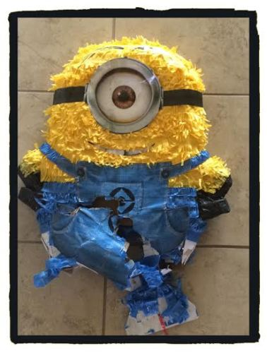 It's probably hard to tell, but this mangled mess of Minion is the piñata we beat the crap out of, not the disastrous cake I had made.